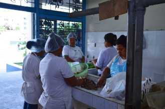 The ladies hard at work cleaning and cutting fish.