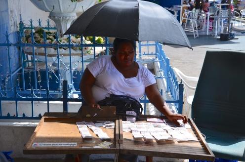 A lottery ticket vendor.